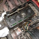 """With the head and carb off, you can see some of the crap still on the number 3 cylinder. • <a style=""""font-size:0.8em;"""" href=""""http://www.flickr.com/photos/34925363@N08/4943163264/"""" target=""""_blank"""">View on Flickr</a>"""